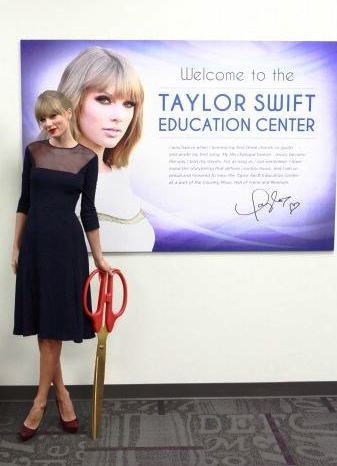 Taylor Swift cutting the ribbon at the Taylor Swift Education Center