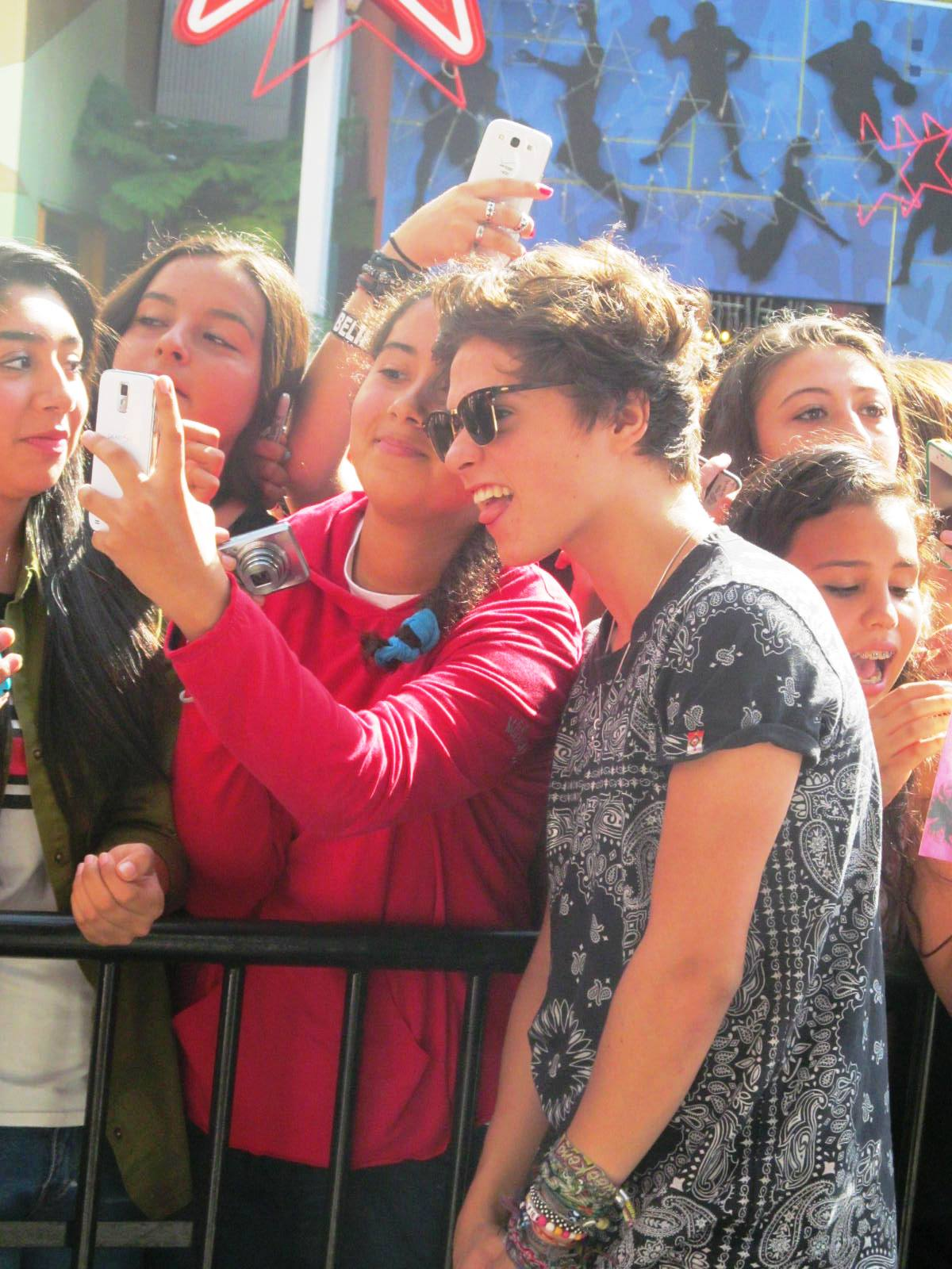 The vamps young hollywood life bradley taking a picture with a us fan that came out last minute for a meet and greet with the uk boy band the vamps m4hsunfo