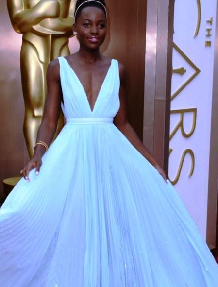 A BEAUTIFUL PALE BLUE PRADA GOWN MAKES LUPITA STAND OUT AT THE OSCARS 2014!