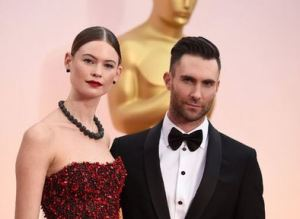 BEHATI PRINSLOO AND ADAM LEVINE BOTH IN ARMANI LOOKING LOVELY AT THE 2015 OSCARS
