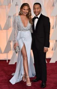 CHRISSY TEIGEN AND JOHN LEGEND AT THE 2015 OSCARS