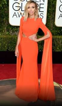 Giuliana Ranic wears an Alex Perry gown as she co-hosts with Ryan Seacrest pre show for E