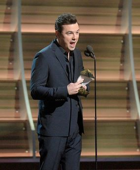 seth mcfarlane on stage at the grammys presenting to Hamilton via New york